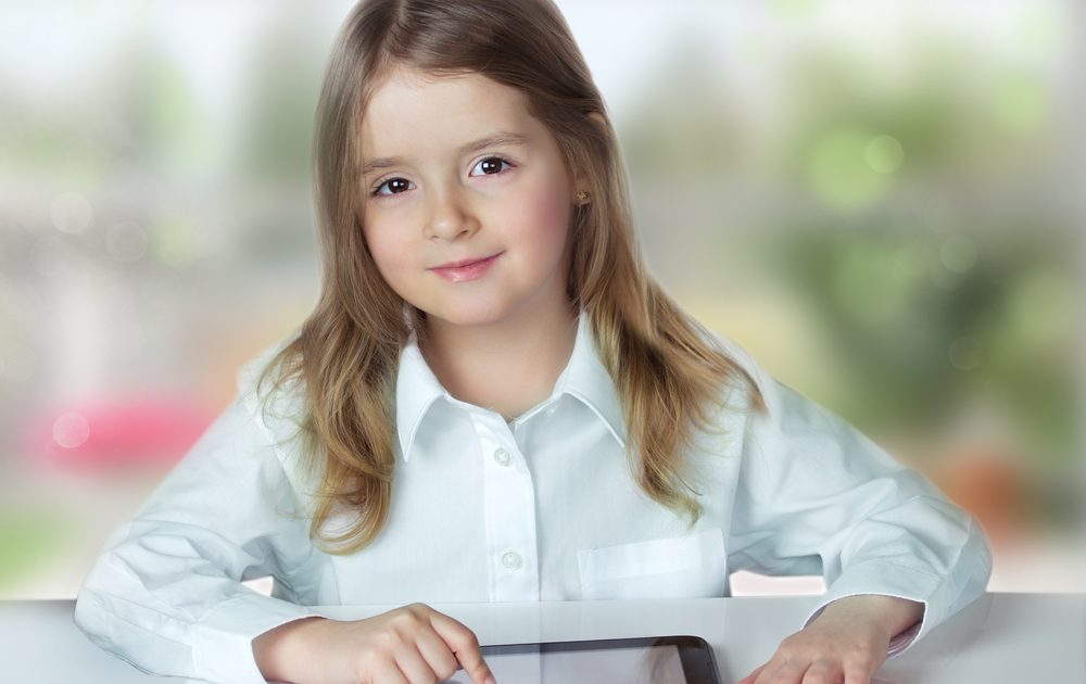 Girl with device representing iPad for education
