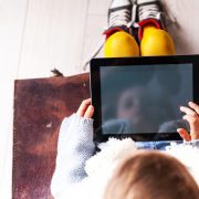 Child on iPad representing iPad use for dyslexic students